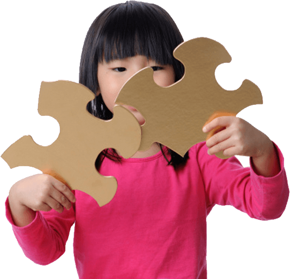 Girl playing with large puzzle pieces